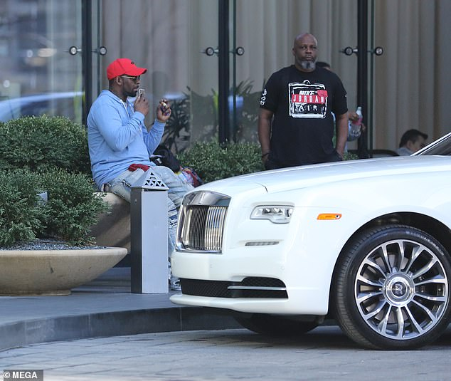 R-Kelly Relaxed By A Rolls Royce While Possible Jail Time Looms 1